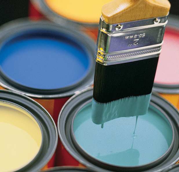 Buckets of paint with brush